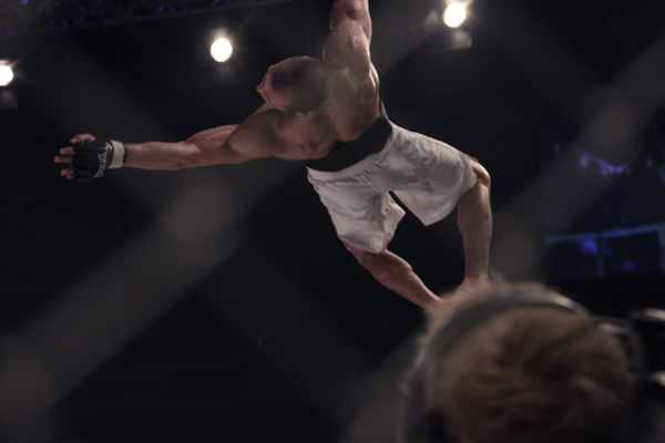 Kuivanen celebrates with a backflip of the cage.