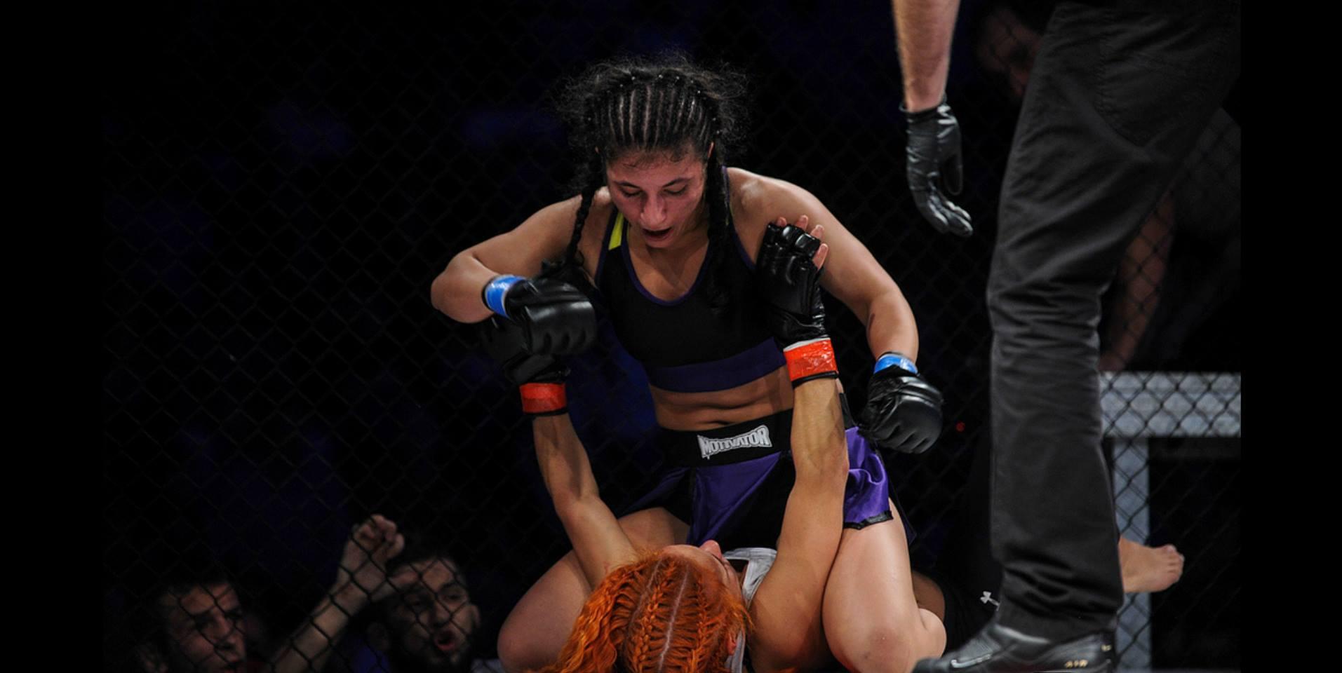 Iman Darabi in her professional debut. Photo by Piotr Pedziszweski for MMA Rocks.