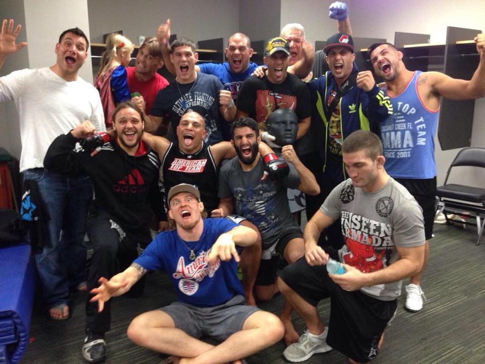 Kakai Celebrating with American Top Team After Bout