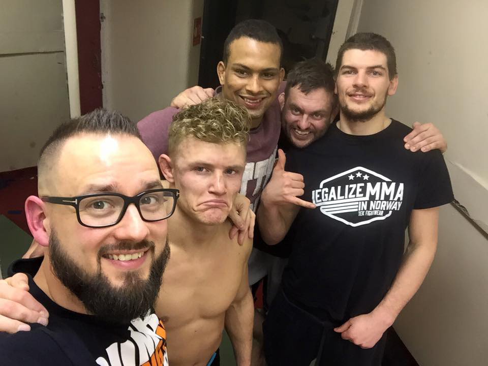 Jonas with coach and team after loss