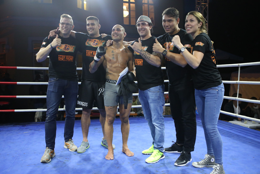 Macedo and his team celebrating victory after a tough fight.